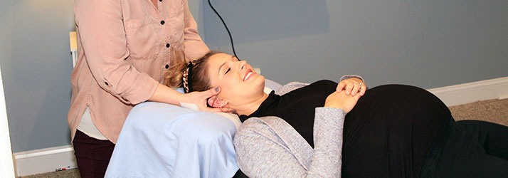 Chiropractor Durham NC Dr. Danielle Fratellone with Pregnant Patient
